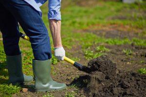 landscaper digging in garden